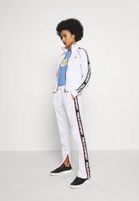 Polo Ralph Lauren - TRICOT - Teplákové kalhoty - white - 1