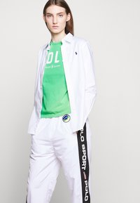 Polo Ralph Lauren - FREESTYLE - Tracksuit bottoms - pure white - 3