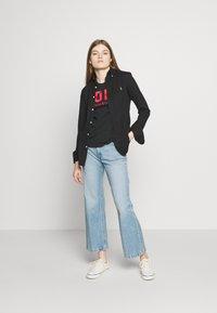 Polo Ralph Lauren - Camiseta estampada - black - 1