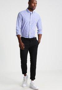 Polo Ralph Lauren - FLAT PANT - Trousers - polo black - 1