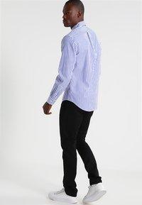 Polo Ralph Lauren - FLAT PANT - Trousers - polo black - 2