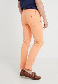 Polo Ralph Lauren - BEDFORD PANT - Spodnie materiałowe - poppy - 2