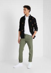 Polo Ralph Lauren - TAILORED PANT - Pantaloni - army olive - 1