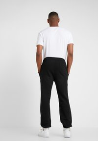 Polo Ralph Lauren - ATHLETIC  - Teplákové kalhoty - black - 2