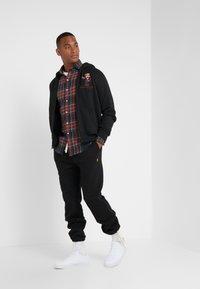 Polo Ralph Lauren - ATHLETIC  - Teplákové kalhoty - black - 1