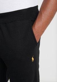 Polo Ralph Lauren - ATHLETIC  - Teplákové kalhoty - black - 4