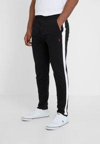 Polo Ralph Lauren - Tracksuit bottoms - polo black - 0