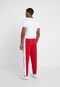 Polo Ralph Lauren - PULL UP PANT - Pantaloni sportivi - red/pure white - 2