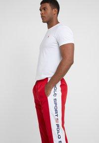Polo Ralph Lauren - PULL UP PANT - Pantaloni sportivi - red/pure white - 4