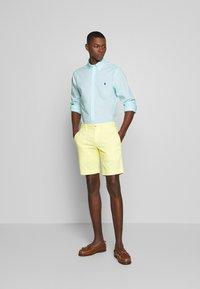 Polo Ralph Lauren - BEDFORD - Shorts - bristol yellow - 1