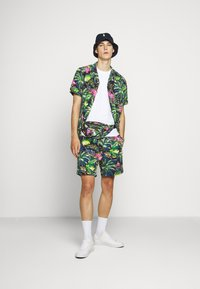 Polo Ralph Lauren - CLASSIC FIT PREPSTER - Shorts - flamingo  print - 1
