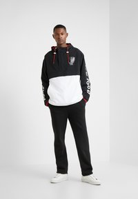 Polo Ralph Lauren - WING HALF ZIP JACKET - Lehká bunda - black/ white - 1
