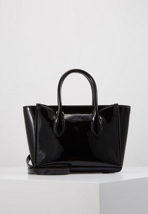 PATENT MINI SLOANE - Bolso de mano - black