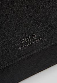 Polo Ralph Lauren - PEBBLE FLIGHT BAG - Umhängetasche - black - 6
