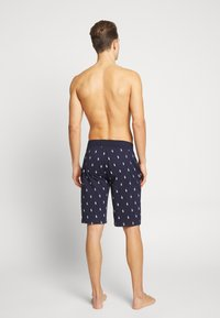 Polo Ralph Lauren - PRINTED LIQUID - Pyjama bottoms - cruise navy