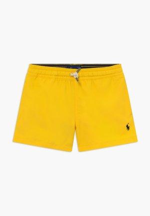 TRAVELER - Plavky - chrome yellow