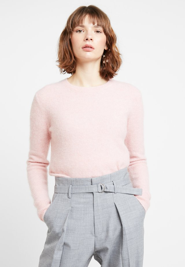 Stickad tröja - pink dogwood