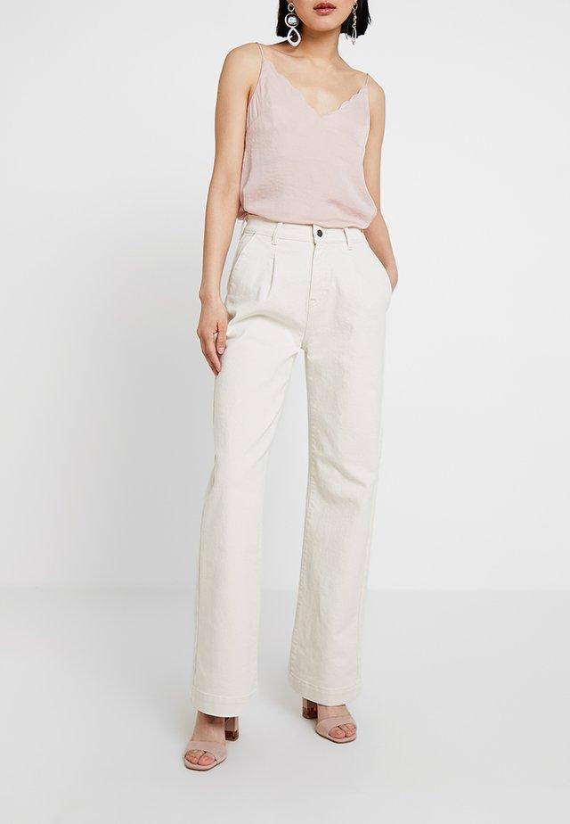 POSALBA WIDE - Flared Jeans - beige