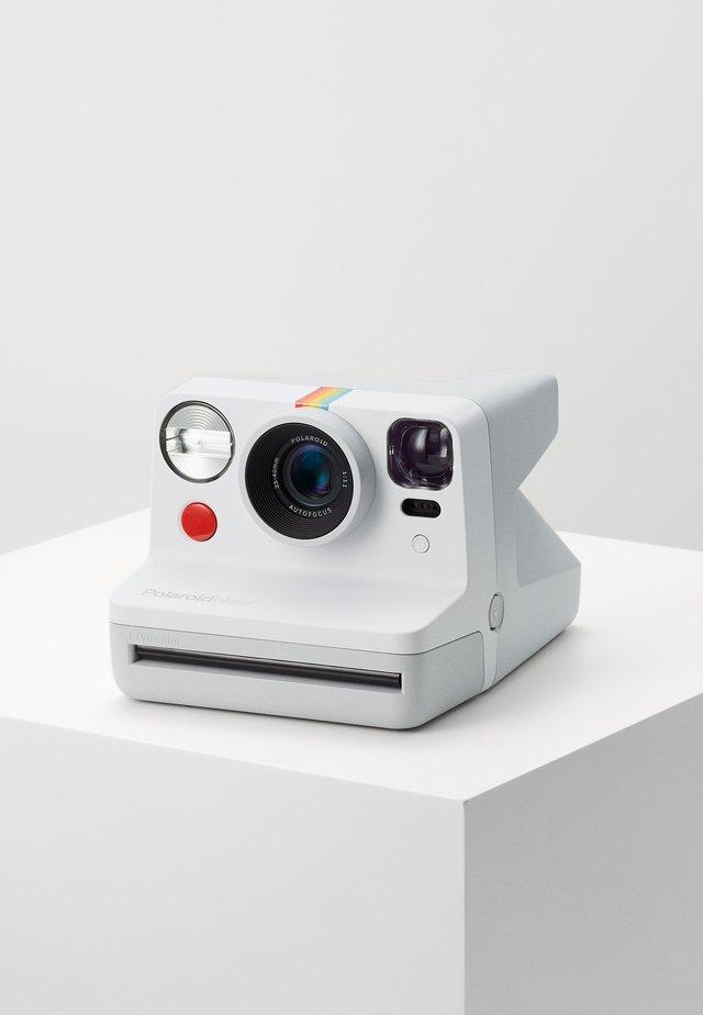 NOW - Cámara - white