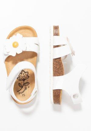Sandaalit nilkkaremmillä - bianco