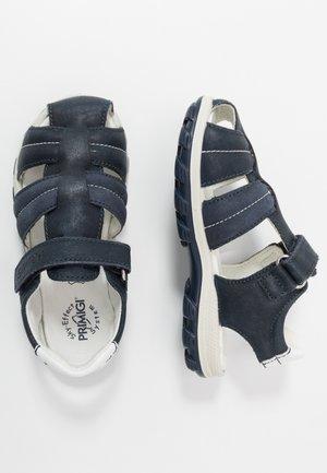 Sandaalit nilkkaremmillä - blu