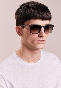 Prada Linea Rossa - Sluneční brýle - black - 1