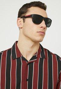 Prada Linea Rossa - Sonnenbrille - matte black/grey - 1