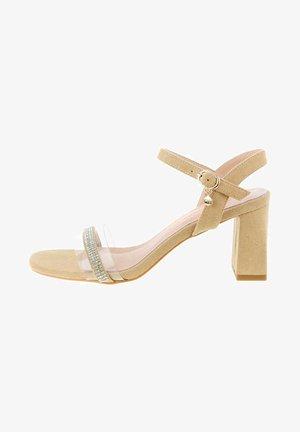 DELLONATO - Ankle cuff sandals - beige