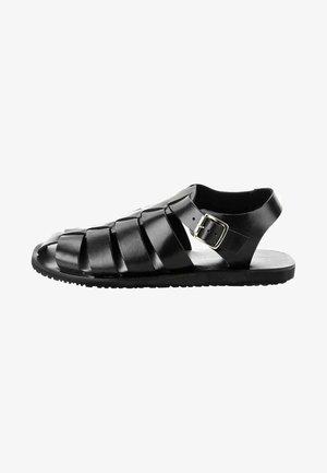 QUARTAJA - Sandaalit nilkkaremmillä - black