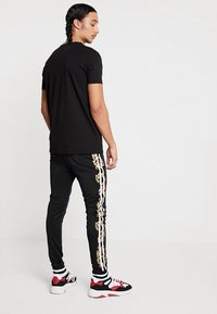 Project X Paris - BAROQUE TRACKSUIT - Pantaloni sportivi - black - 2