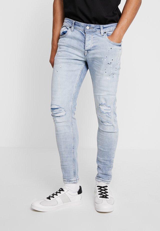 DISTRESSED  - Jeans Skinny Fit - stonewash