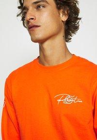 Primitive - NARUTO COMBAT - Bluzka z długim rękawem - orange - 3