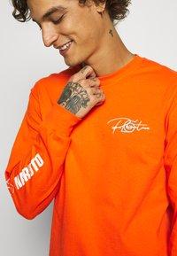 Primitive - NARUTO COMBAT - Bluzka z długim rękawem - orange - 5
