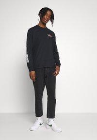 Primitive - NARUTO COMBAT - Long sleeved top - black - 1