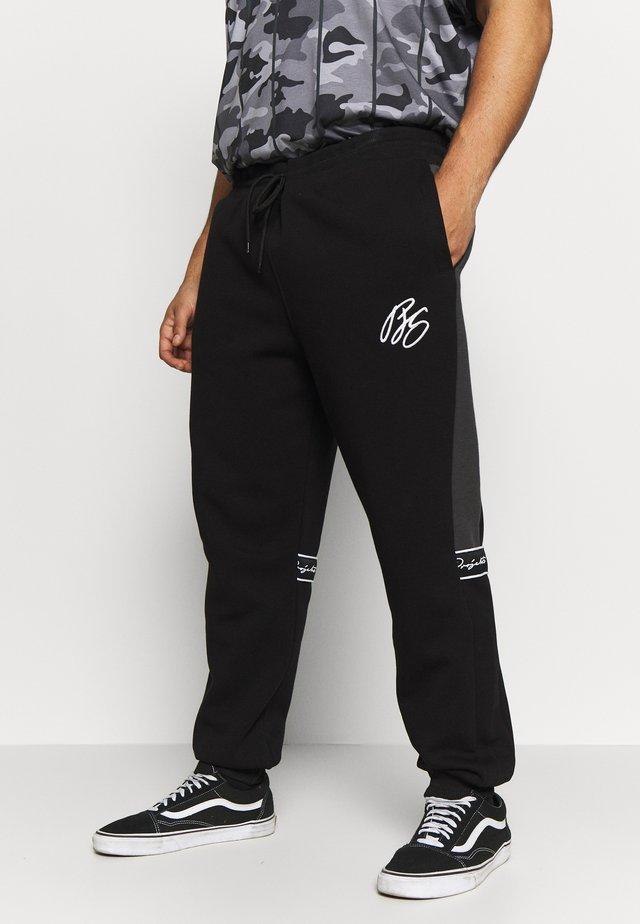 MCKINNON TAPED JOGGERS - Spodnie treningowe - black