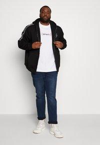 Projekts NYC - MCKINNON ZIP THROUGH TAPED HOODIE - Zip-up hoodie - black - 1