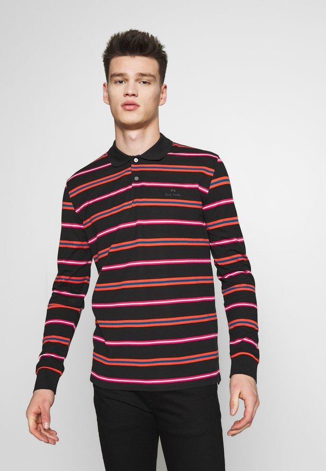 FIT  - Polo shirt - black