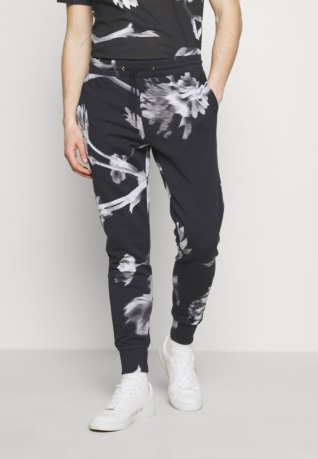 GENTS FLORAL PRINT - Tracksuit bottoms - black