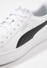Puma - VIKKY STACKED - Sneakersy niskie - white/black - 2