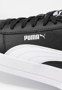 Puma - CARINA  - Sneakersy niskie - black/white - 2
