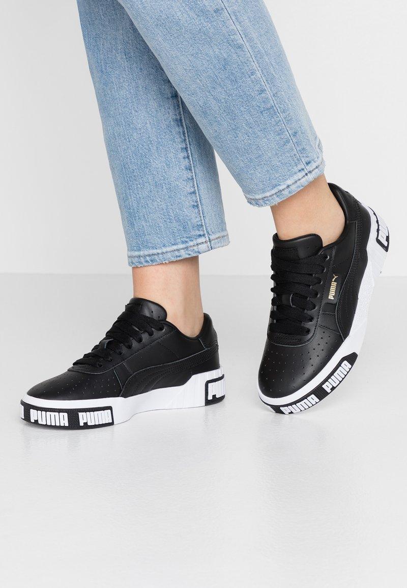 Puma - CALI BOLD - Sneaker low - black/metallic gold
