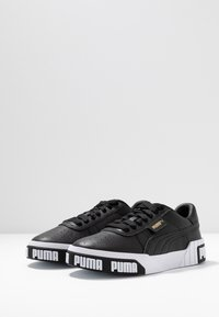 Puma - CALI BOLD - Trainers - black/metallic gold - 4