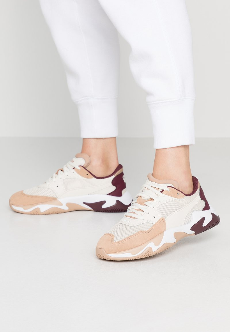 Puma - STORM ORIGIN - Sneaker low - nougat/whisper white