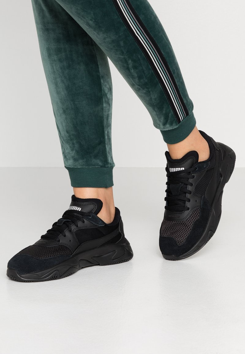 Puma - STORM ORIGIN - Trainers - black