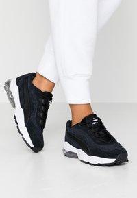 Puma - CELL STELLAR TONAL - Sneakers laag - black/team gold - 0