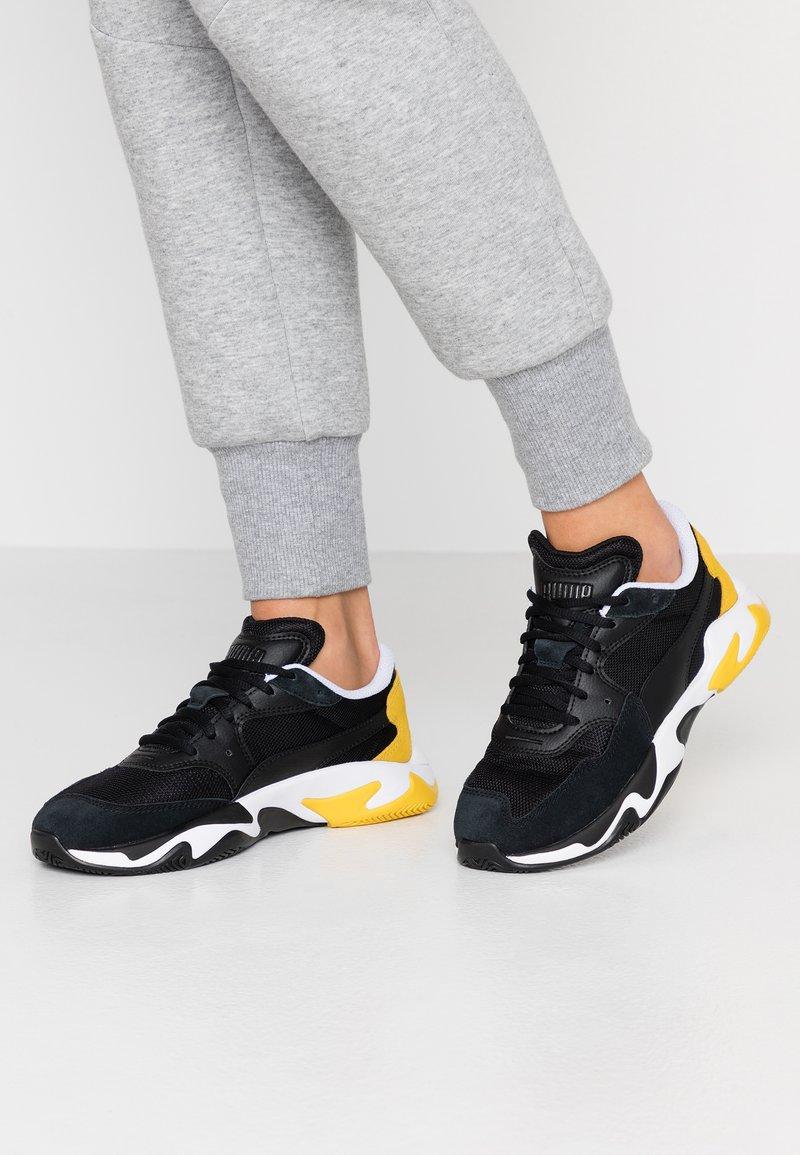 Puma - STORM ADRENALINE - Trainers - black/yellow