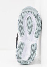 Puma - STORM.Y POP - Sneakersy niskie - black - 6