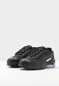 Puma - CELL STELLAR GLOW  - Sneakersy niskie - black/purple heather - 4