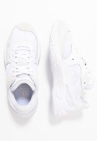 Puma - STORM ORIGIN - Sneakers laag - white - 1