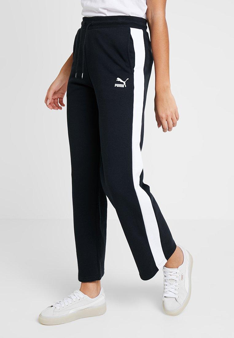 Puma - CLASSICS PANTS - Jogginghose - black/white